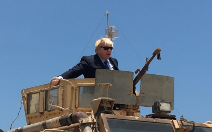 As Parliament argues over the National Insurance U-turn, Boris Johnson rides an armoured vehicle in Mogadishu