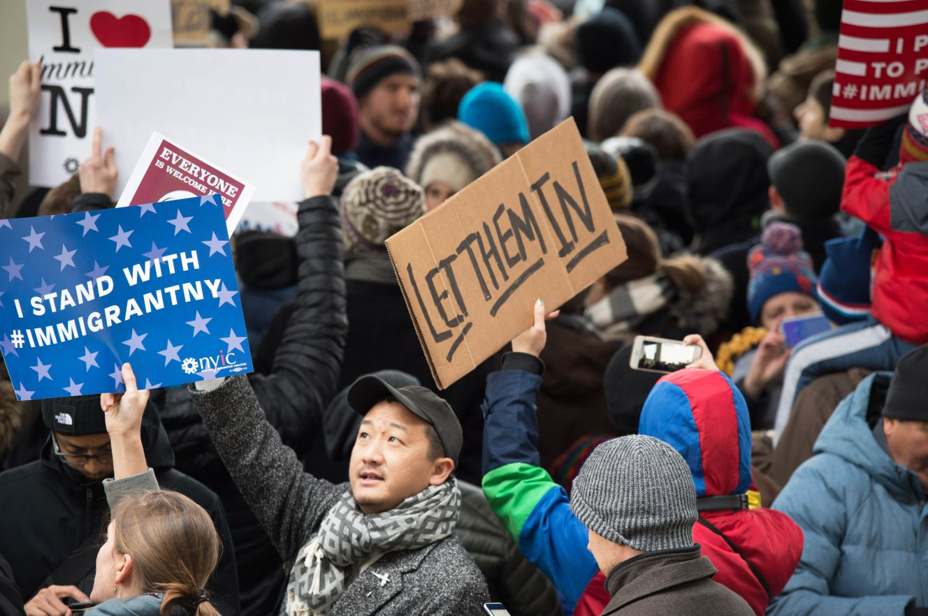 Federal judge grants stay for those detained under Trump's travel ban